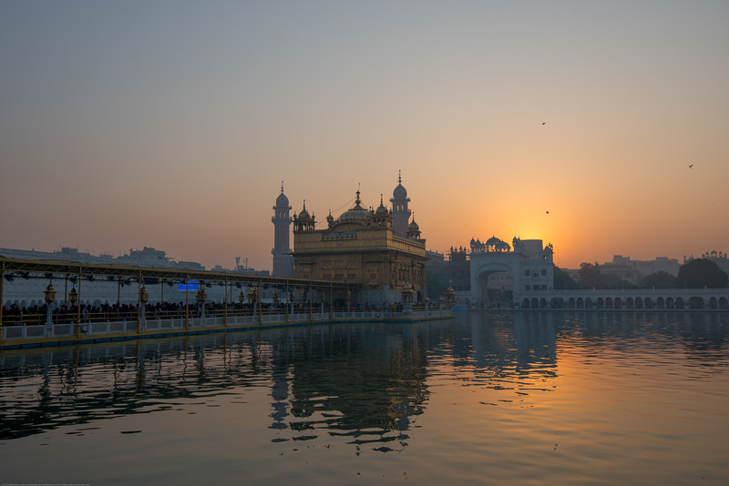 "Sunrise at The Harmandir Sahib (Punjabi: ਹਰਿਮੰਦਰ ਸਾਹਿਬ), also Darbar Sahib (Punjabi: ਦਰਬਾਰ ਸਾਹਿਬ, )(The abode of God), and informally called the ""Golden Temple"", is the holiest Sikh gurdwara located in the city of Amritsar, Punjab, North India."