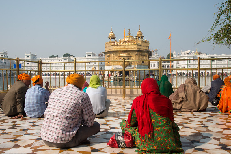"""Silent prayers at the Golden Temple while the Gurubani is played on the loudspeakers.<br /> <br /> The Harmandir Sahib (Punjabi: ਹਰਿਮੰਦਰ ਸਾਹਿਬ), also Darbar Sahib (Punjabi: ਦਰਬਾਰ ਸਾਹਿਬ, )(The abode of God), and informally called the """"Golden Temple"""", is the holiest Sikh gurdwara located in the city of Amritsar, Punjab, North India."""
