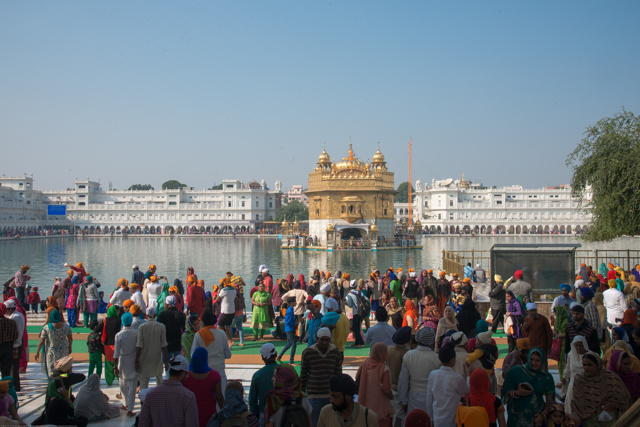 """Over a hundred thousand visit the Golden Temple daily. The Harmandir Sahib (Punjabi: ਹਰਿਮੰਦਰ ਸਾਹਿਬ), also Darbar Sahib (Punjabi: ਦਰਬਾਰ ਸਾਹਿਬ, )(The abode of God), and informally called the """"Golden Temple"""", is the holiest Sikh gurdwara located in the city of Amritsar, Punjab, North India."""