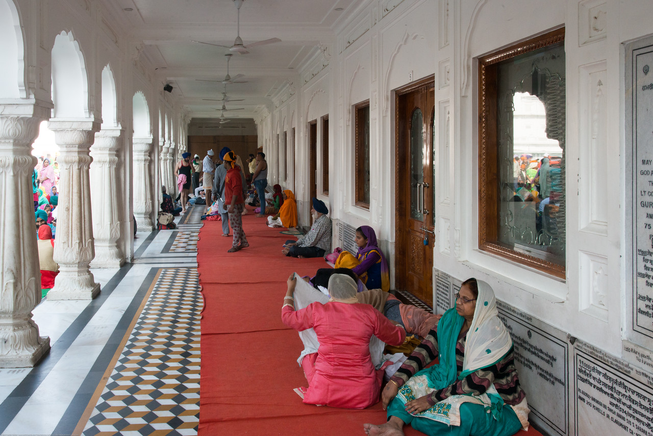 """Many stay over and pray at the Golden Temple. The Harmandir Sahib (Punjabi: ਹਰਿਮੰਦਰ ਸਾਹਿਬ), also Darbar Sahib (Punjabi: ਦਰਬਾਰ ਸਾਹਿਬ, )(The abode of God), and informally called the """"Golden Temple"""", is the holiest Sikh gurdwara located in the city of Amritsar, Punjab, North India."""
