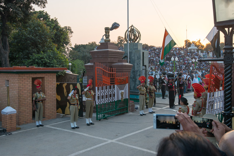 Lowering of the flags at the Indo-Pak border. Attari/Wagah (Punjabi (Gurmukhi): ਵਾਹਗਾ, Hindi: वाघा, Urdu: واہگہ‎) border lies on the Grand Trunk Road between the cities of Amritsar, Punjab, India, and Lahore, Punjab, Pakistan.