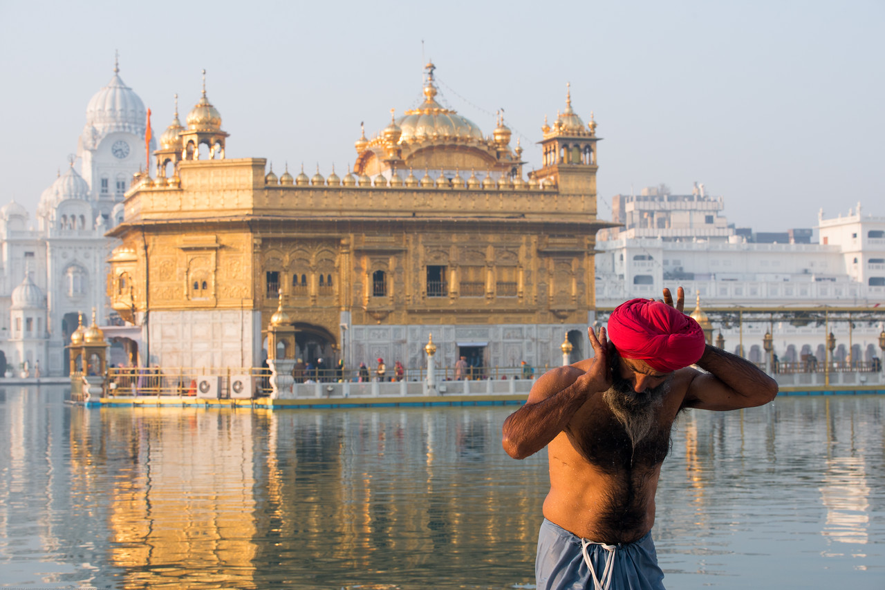 """Holy dip in the morning at The Harmandir Sahib (Punjabi: ਹਰਿਮੰਦਰ ਸਾਹਿਬ), also Darbar Sahib (Punjabi: ਦਰਬਾਰ ਸਾਹਿਬ, )(The abode of God), and informally called the """"Golden Temple"""", is the holiest Sikh gurdwara located in the city of Amritsar, Punjab, North India."""