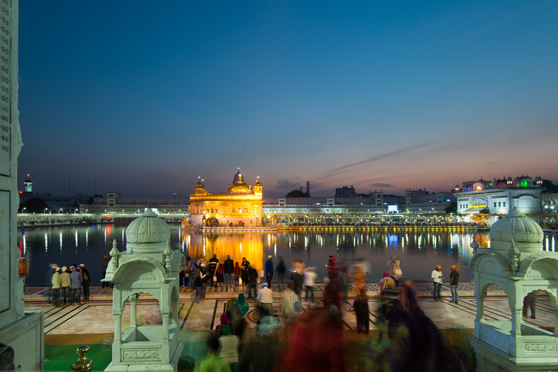 """At the Golden temple a golden hour picture.<br /> <br /> The Harmandir Sahib (Punjabi: ਹਰਿਮੰਦਰ ਸਾਹਿਬ), also Darbar Sahib (Punjabi: ਦਰਬਾਰ ਸਾਹਿਬ, )(The abode of God), and informally called the """"Golden Temple"""", is the holiest Sikh gurdwara located in the city of Amritsar, Punjab, North India."""