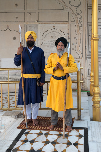 "Guards keep a gentle but watchful eye at The Harmandir Sahib (Punjabi: ਹਰਿਮੰਦਰ ਸਾਹਿਬ), also Darbar Sahib (Punjabi: ਦਰਬਾਰ ਸਾਹਿਬ, )(The abode of God), and informally called the ""Golden Temple"", is the holiest Sikh gurdwara located in the city of Amritsar, Punjab, North India."