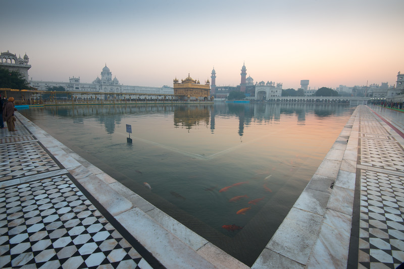 "Just before dawn at The Harmandir Sahib (Punjabi: ਹਰਿਮੰਦਰ ਸਾਹਿਬ), also Darbar Sahib (Punjabi: ਦਰਬਾਰ ਸਾਹਿਬ, )(The abode of God), and informally called the ""Golden Temple"", is the holiest Sikh gurdwara located in the city of Amritsar, Punjab, North India."