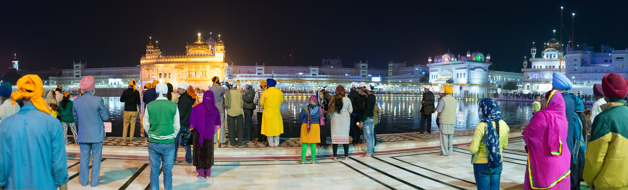 """Night panoramic view of The Harmandir Sahib (Punjabi: ਹਰਿਮੰਦਰ ਸਾਹਿਬ), (The abode of God), also  called the """"Golden Temple"""", which is the holiest Sikh gurdwara located in the city of Amritsar, Punjab, North India."""