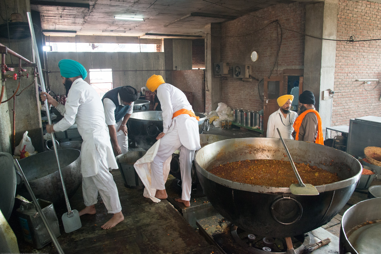 """Very large quantities of food is cooked in massive vessels for the free langar at the Golden Temple.<br /> <br /> The Harmandir Sahib (Punjabi: ਹਰਿਮੰਦਰ ਸਾਹਿਬ), also Darbar Sahib (Punjabi: ਦਰਬਾਰ ਸਾਹਿਬ, )(The abode of God), and informally called the """"Golden Temple"""", is the holiest Sikh gurdwara located in the city of Amritsar, Punjab, North India."""