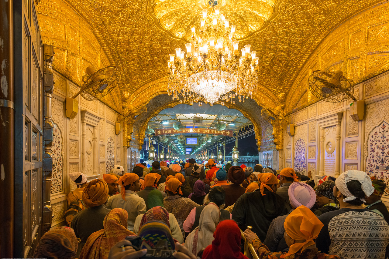 """Long but orderly queues at the Golden Temple entrance.<br /> <br /> The Harmandir Sahib (Punjabi: ਹਰਿਮੰਦਰ ਸਾਹਿਬ), also Darbar Sahib (Punjabi: ਦਰਬਾਰ ਸਾਹਿਬ, )(The abode of God), and informally called the """"Golden Temple"""", is the holiest Sikh gurdwara located in the city of Amritsar, Punjab, North India."""
