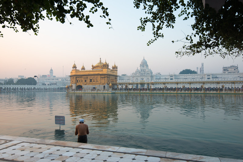 "Early morning at The Harmandir Sahib (Punjabi: ਹਰਿਮੰਦਰ ਸਾਹਿਬ), also Darbar Sahib (Punjabi: ਦਰਬਾਰ ਸਾਹਿਬ, )(The abode of God), and informally called the ""Golden Temple"", is the holiest Sikh gurdwara located in the city of Amritsar, Punjab, North India."