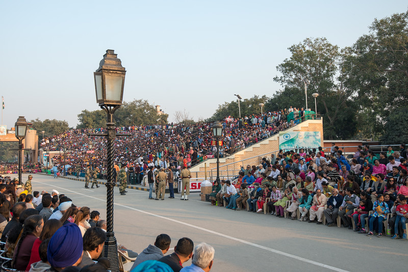 Big crowds attend at the Indian side of the Indo-Pak border. Attari/Wagah (Punjabi (Gurmukhi): ਵਾਹਗਾ, Hindi: वाघा, Urdu: واہگہ‎) border lies on the Grand Trunk Road between the cities of Amritsar, Punjab, India, and Lahore, Punjab, Pakistan.