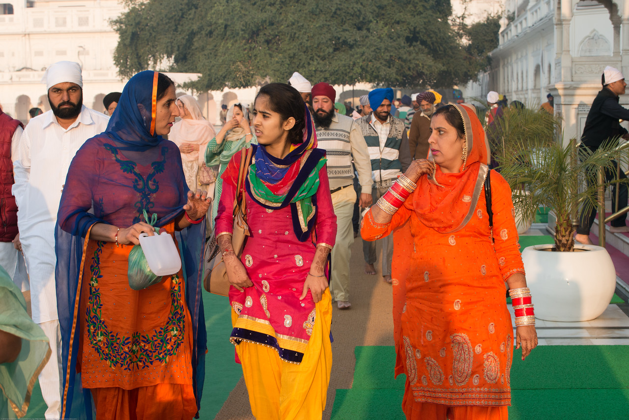 """Women at The Harmandir Sahib (Punjabi: ਹਰਿਮੰਦਰ ਸਾਹਿਬ), also Darbar Sahib (Punjabi: ਦਰਬਾਰ ਸਾਹਿਬ, )(The abode of God), and informally called the """"Golden Temple"""", is the holiest Sikh gurdwara located in the city of Amritsar, Punjab, North India."""