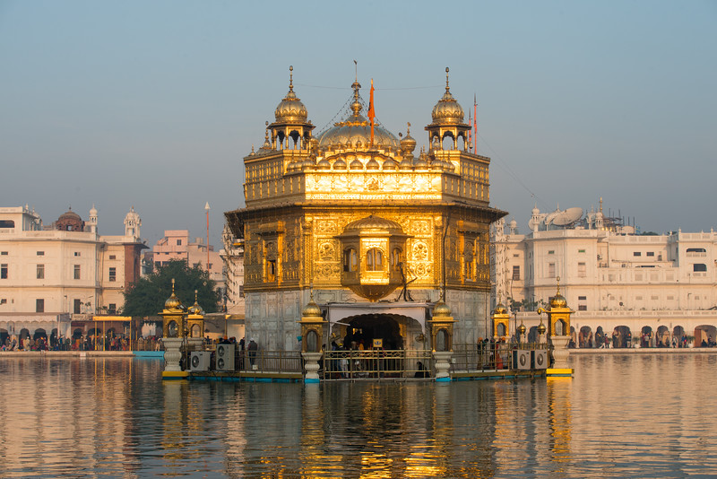 "Glowing reflection of the morning Sun at The Harmandir Sahib (Punjabi: ਹਰਿਮੰਦਰ ਸਾਹਿਬ), also Darbar Sahib (Punjabi: ਦਰਬਾਰ ਸਾਹਿਬ, )(The abode of God), and informally called the ""Golden Temple"", is the holiest Sikh gurdwara located in the city of Amritsar, Punjab, North India."