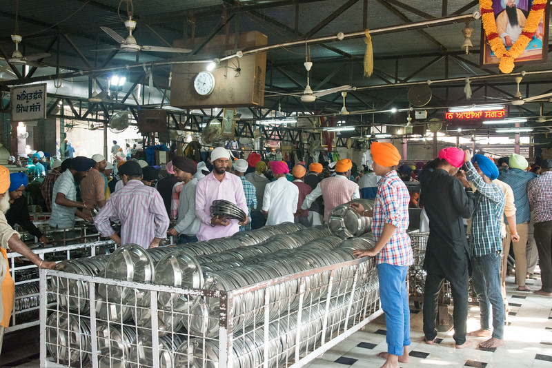 """Thousands are fed daily at the langar at the Golden Temple.<br /> <br /> The Harmandir Sahib (Punjabi: ਹਰਿਮੰਦਰ ਸਾਹਿਬ), also Darbar Sahib (Punjabi: ਦਰਬਾਰ ਸਾਹਿਬ, )(The abode of God), and informally called the """"Golden Temple"""", is the holiest Sikh gurdwara located in the city of Amritsar, Punjab, North India."""