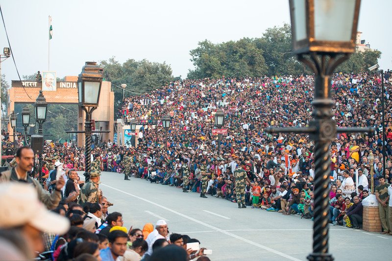 Very large crowds attend and cheer their respective armed forces.<br /> <br /> Attari/Wagah (Punjabi (Gurmukhi): ਵਾਹਗਾ, Hindi: वाघा, Urdu: واہگہ‎) border lies on the Grand Trunk Road between the cities of Amritsar, Punjab, India, and Lahore, Punjab, Pakistan.