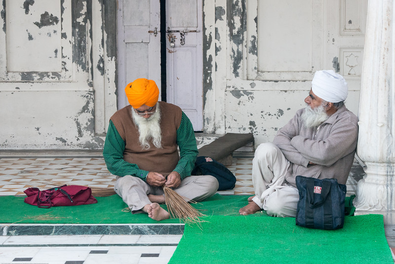 "Elderly men doing service at The Harmandir Sahib (Punjabi: ਹਰਿਮੰਦਰ ਸਾਹਿਬ), also Darbar Sahib (Punjabi: ਦਰਬਾਰ ਸਾਹਿਬ, )(The abode of God), and informally called the ""Golden Temple"", is the holiest Sikh gurdwara located in the city of Amritsar, Punjab, North India."