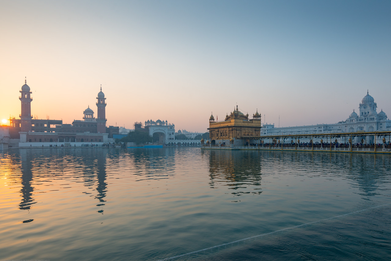 "Sunrise over The Harmandir Sahib (Punjabi: ਹਰਿਮੰਦਰ ਸਾਹਿਬ), also Darbar Sahib (Punjabi: ਦਰਬਾਰ ਸਾਹਿਬ, )(The abode of God), and informally called the ""Golden Temple"", is the holiest Sikh gurdwara located in the city of Amritsar, Punjab, North India."