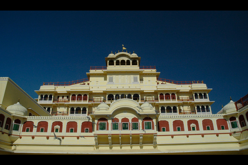 "Architectural beauty of the ""City Palace"", Jaipur.  Chandra Mahal is an elegant seven-storied building. It is the residence of the ex-ruler. It houses a beautiful museum, an armoury and several other rooms. Chandra Mahal is located in the centre of the city palace hence gives a panoramic view of the gardens and the Jaipur city. The museum of Maharaja Sawai Jai Singh gives a close picture of the arms & ammunitions and other art materials including the carpets of his period. It all holds a huge collection of arms and weapons of the ancient period. Each story of the building has a specific name."