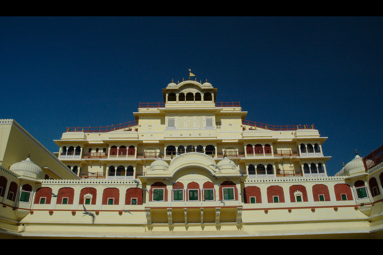 """Architectural beauty of the """"City Palace"""", Jaipur.  Chandra Mahal is an elegant seven-storied building. It is the residence of the ex-ruler. It houses a beautiful museum, an armoury and several other rooms. Chandra Mahal is located in the centre of the city palace hence gives a panoramic view of the gardens and the Jaipur city. The museum of Maharaja Sawai Jai Singh gives a close picture of the arms & ammunitions and other art materials including the carpets of his period. It all holds a huge collection of arms and weapons of the ancient period. Each story of the building has a specific name."""