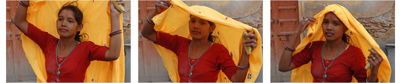 Portrait of traditionally bright saree dressed Rajasthani lady sweeper near Hawa Mahal, Jaipur, Rajasthan, RJ, India.