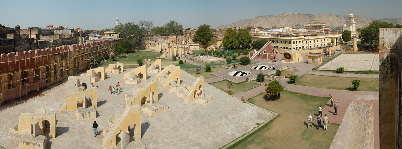 Panoramic image of Jantar Mantar, Jaipur, Rajasthan, India<br /> <br /> <br /> In Sanskrit, 'Jantar Mantar' is used for 'Magical Devices' and it is undoubtedly so with the huge masonry instruments, which were placed here to measure 'the harmony of the heavens'. Conceived and constructed by Sawai Raja Jai Singh II, it was completed in seven years (1728 to 1734). Each instrument that forms a part of this observatory is assigned and used for a particular function and is known to give an accurate reading. The Samrat Yantra is a large sundial that looks like a triangular structure and is marked with hours and minutes. The arc at the left shows the time from sunrise to midday while the arc at the right side shows the time from midday to sunset. The time is read by observing where the shadow is sharpest at the time. The sundials have been constructed on latitude 27o north and to adjust the reading to the Indian standard Time (IST), one has to add anything between 1 minute 15 seconds to 32 minutes according to the time of year and solar position. The Dhruva Yantra is used to locate the position of 12 Zodiac signs and also the Pole Star at night. The traditional unit of measurement started with the smallest unit being 'human breath' that has been calculated to be of 6 seconds duration. According to this scale, 4 breaths or 24 seconds equals 1 pal, 60 pals or 24 minutes equals 1 ghadi and 60 ghadis or 24 hours equals 1 day. The Narivalya Yantra is a distinctive sundial with two dials - the first dial facing south reads time when the sun is in the southern hemisphere, i.e., from 21 September to 21 March each year and the other one facing north reads time for the rest of the year when the Sun is in the northern hemisphere, i.e., from 21 March to 21 September. The various other instruments include Jai Singh's seat (the seat of the Observer), Kranti Yantra used for direct measurement of the longitude and latitude of the extraterrestrial bodies, Raj Yantra or the King of Instruments used only once