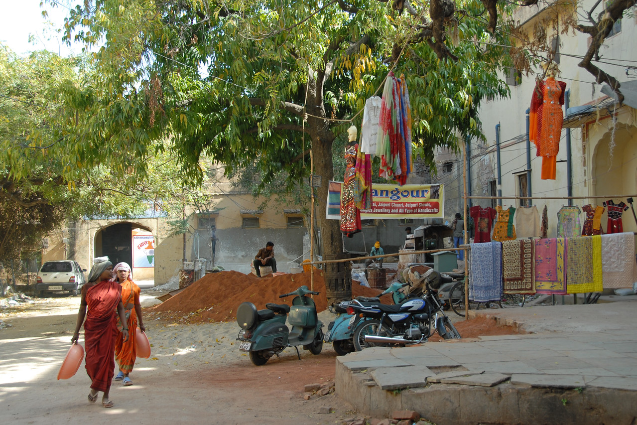 Ladies working on the street getting attracted & attention drawn by by Pinky Saree Centre in Jaipur, Rajasthan