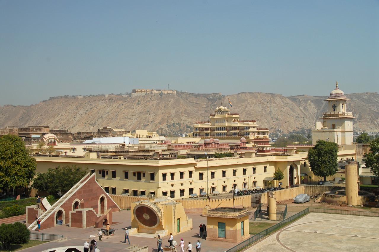 Jantar Mantar, Jaipur, Rajasthan, India<br /> <br /> <br /> In Sanskrit, 'Jantar Mantar' is used for 'Magical Devices' and it is undoubtedly so with the huge masonry instruments, which were placed here to measure 'the harmony of the heavens'. Conceived and constructed by Sawai Raja Jai Singh II, it was completed in seven years (1728 to 1734). Each instrument that forms a part of this observatory is assigned and used for a particular function and is known to give an accurate reading. The Samrat Yantra is a large sundial that looks like a triangular structure and is marked with hours and minutes. The arc at the left shows the time from sunrise to midday while the arc at the right side shows the time from midday to sunset. The time is read by observing where the shadow is sharpest at the time. The sundials have been constructed on latitude 27o north and to adjust the reading to the Indian standard Time (IST), one has to add anything between 1 minute 15 seconds to 32 minutes according to the time of year and solar position. The Dhruva Yantra is used to locate the position of 12 Zodiac signs and also the Pole Star at night. The traditional unit of measurement started with the smallest unit being 'human breath' that has been calculated to be of 6 seconds duration. According to this scale, 4 breaths or 24 seconds equals 1 pal, 60 pals or 24 minutes equals 1 ghadi and 60 ghadis or 24 hours equals 1 day. The Narivalya Yantra is a distinctive sundial with two dials - the first dial facing south reads time when the sun is in the southern hemisphere, i.e., from 21 September to 21 March each year and the other one facing north reads time for the rest of the year when the Sun is in the northern hemisphere, i.e., from 21 March to 21 September. The various other instruments include Jai Singh's seat (the seat of the Observer), Kranti Yantra used for direct measurement of the longitude and latitude of the extraterrestrial bodies, Raj Yantra or the King of Instruments used only once a year to calculate