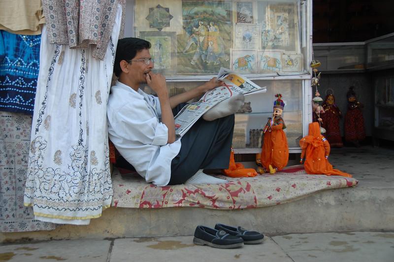 Shop owner waiting for customers. Jaipur, Rajasthan. India.
