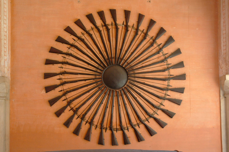 "Guns and other ammo in the City Palace, Jaipur.<br /> <br /> In the heart of the old city is the ""City Palace"" with its series of courtyards, gardens and buildings. The museum of Maharaja Sawai Jai Singh displays arms & ammunitions and other art materials. It all holds a huge collection of arms and weapons of the ancient period. The palace is a blend of Rajasthani and Mughal architecture. The son of the last Maharaja and his family still live in part of the palace.<br /> <br /> The Mubarak Mahal (Welcome Palace) was built in late 19th century by Maharaja Sawai Madho Singh II as a reception center for visiting dignitaries. It now forms part of the Maharaja Sawai Mansingh II Museum."