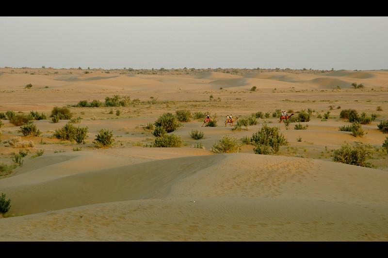 Riding into the Sam sand dune desert of Jaisalmer, Rajasthan, India.