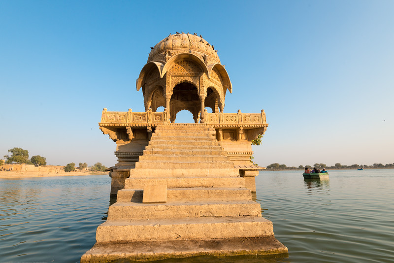 Gadisar lake built by Maharaja Gadsi Singh is surrounded by temples and tombs of saints. Tourist often do boating here. Jaisalmer, Rajasthan, India.