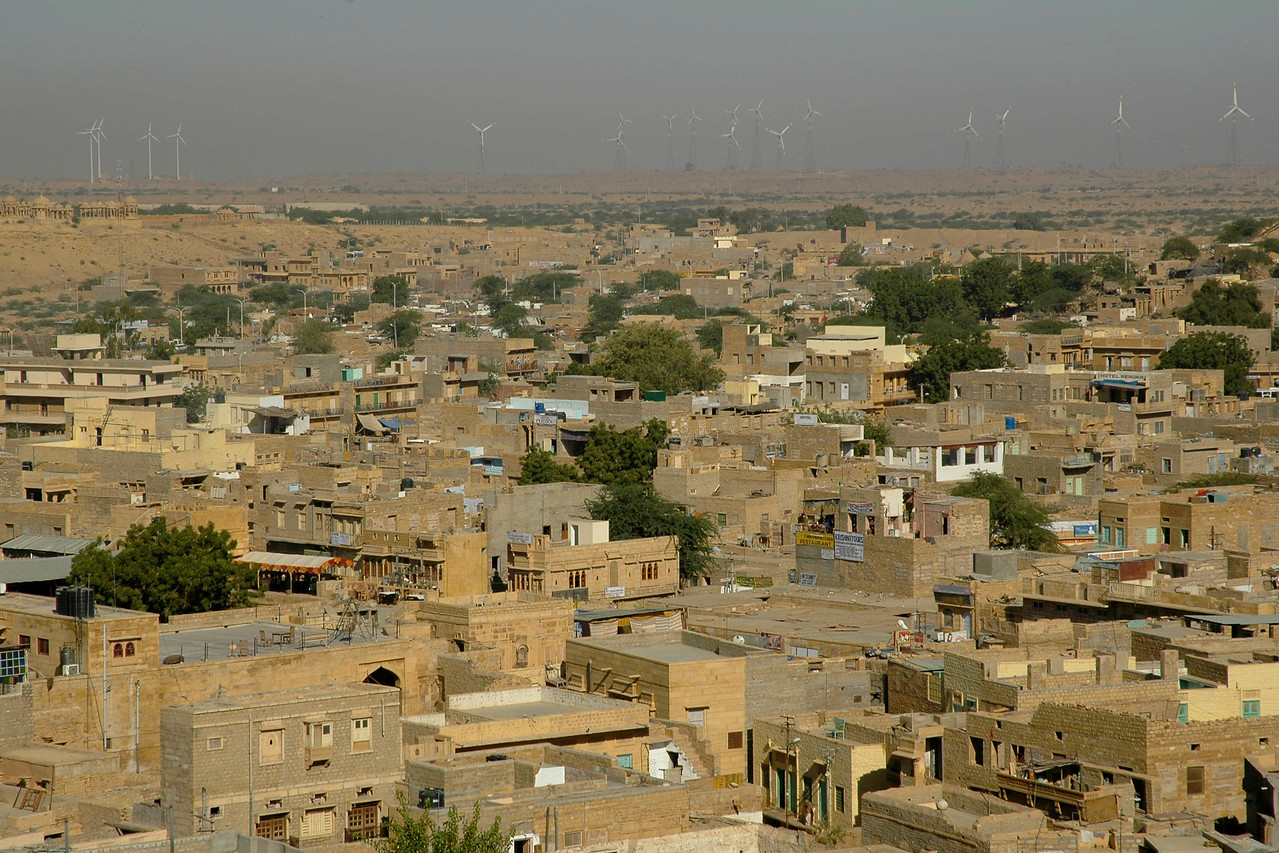 View of the city from Jaisalmer Fort, Rajasthan. India. Seen at the back are wind powered alternate engery towers