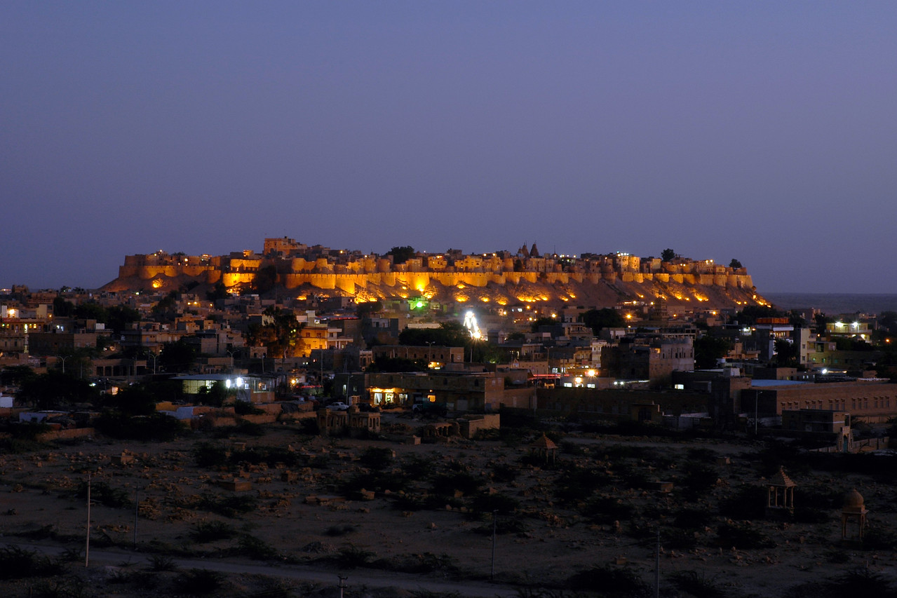 View of Jaisalmer Fort from sunset point at Vyas Chatri, Jaisalmer, Rajasthan, India. There are two groups of Cenotaphs (Vyas Chhattri for Brahmins and Bada Bagh for the royal families) situated at the end of town giving a spectacular view of the Jaisalmer Fort and the Sunset opposite it.