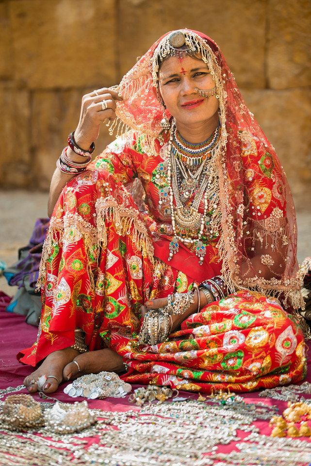 Portrait of a Kathputli (Puppet) maker. Kathputli means a puppet which is made entirely from wood. However it is made out of wood, cotton cloth and metal wire. Both women and men make the kathputli as well as perform to folk songs. Jaisalmer, Rajasthan, India.