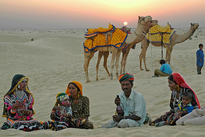Song and dance in the Sam sand dunes of Jaisalmer, Rajasthan, India.  Sam village is on the edge of the Desert National Park. One of the most popular excursions is to the sand dunes on the edge of the park, 42 km from Jaisalmer along a very decent road and then off to the sand.