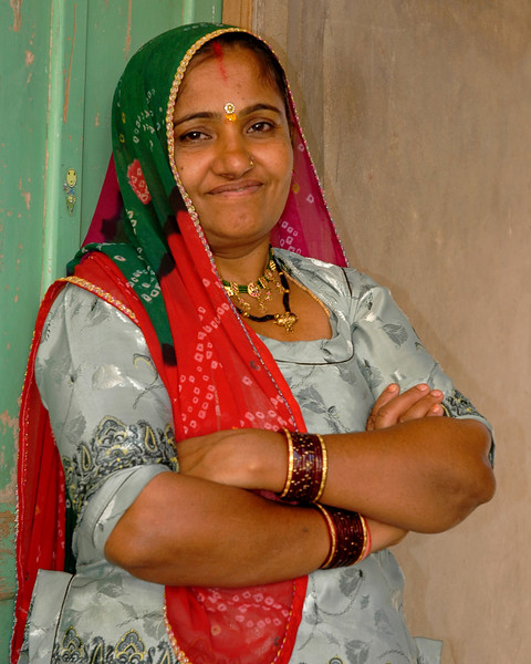 Lady of the house waiting at the entrance to her home in Jaisalmer City, Rajasthan, India.