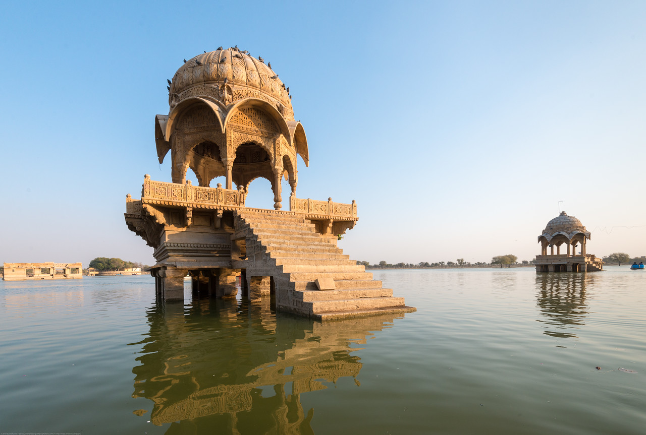 Gadisar lake was built by Maharaja Gadsi Singh, taking the advantage of a natural declivity that already retained some water. It is surrounded by temples and tombs of saints. Tourist often do boating here. Jaisalmer, Rajasthan, India.