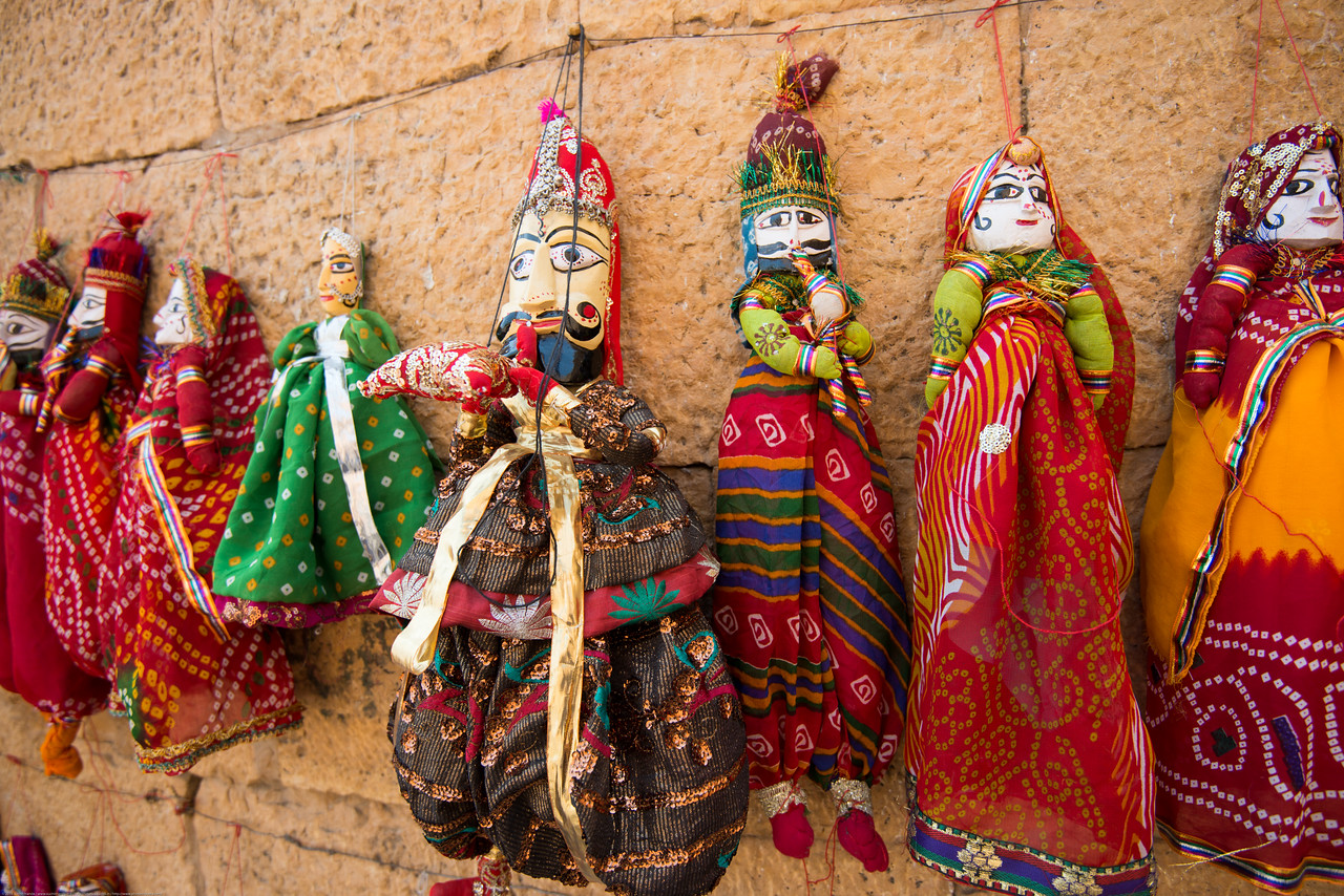 Kathputli (Puppet) Jaisalmer, Rajasthan, India. Rajasthani string puppetry is vibrant and thriving. These handmade wooden puppets are much more than just plaything or decorative dolls. They are a part of the traditional performance of puppetry – narrating an event from history, myths, folklore or legend, complete with music and speech. They are the repository of traditional wisdom, knowledge and social mores. Within them are contained the oral history of the region.<br /> <br /> The tradition of handmade string puppets of Rajasthan is more than a thousand years old. It is known as 'Kaathputli' ('kaath' means wood, and 'putli' is puppet, i.e. wooden puppet) and mainly practiced by the Bhat community.