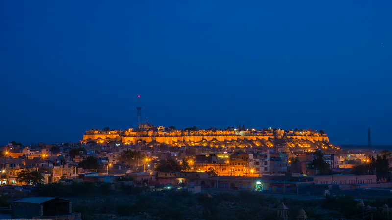 Post sunset blue hour view of the Fort. Sunset point at Vyas Chatri, Jaisalmer, Rajasthan, India. There are two groups of Cenotaphs (Vyas Chhattri for Brahmins and Bada Bagh for the royal families) situated at the end of town giving a spectacular view of the Jaisalmer Fort and the Sunset opposite it. Jaisalmer, Rajasthan, India.