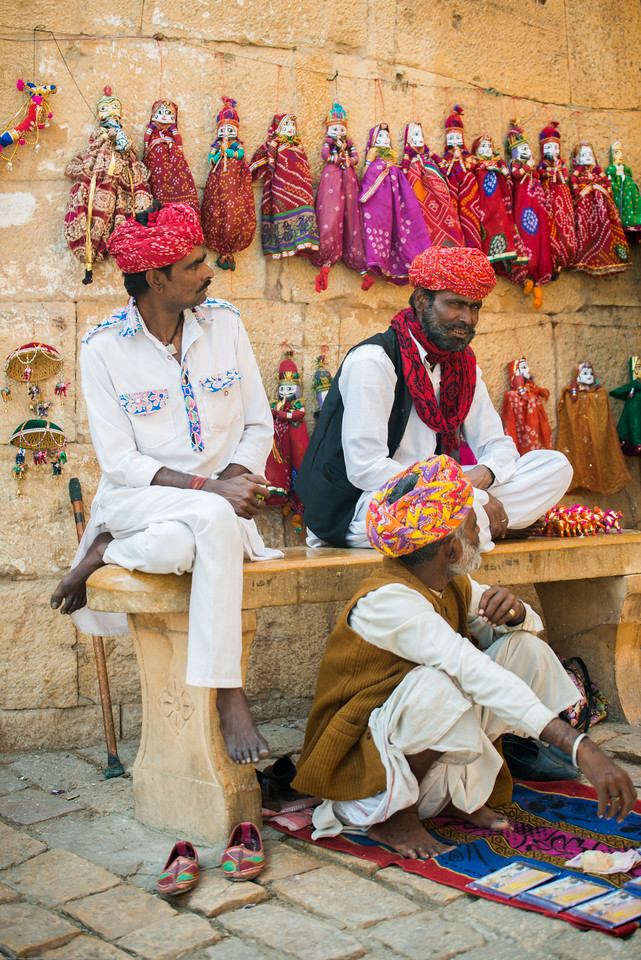 Kathputli (Puppet) makers. Kathputli means a puppet which is made entirely from wood. However it is made out of wood, cotton cloth and metal wire. Both women and men make the kathputli as well as perform to folk songs. Jaisalmer, Rajasthan, India.