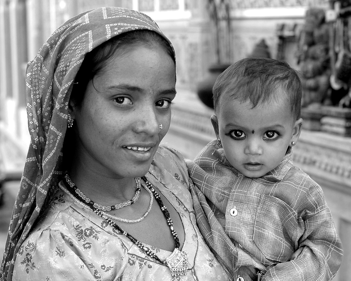 Mother and child street shot in the Jaisalmer City, Rajasthan, India. South Asia.