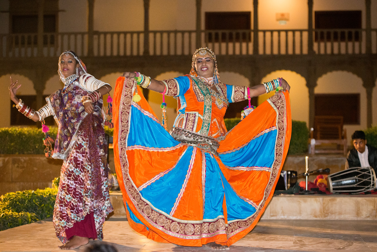 Gypsy women dance with the men playing the music. Rajasthani Folk dancers and musicians, Jaisalmer, Rajasthan, India.