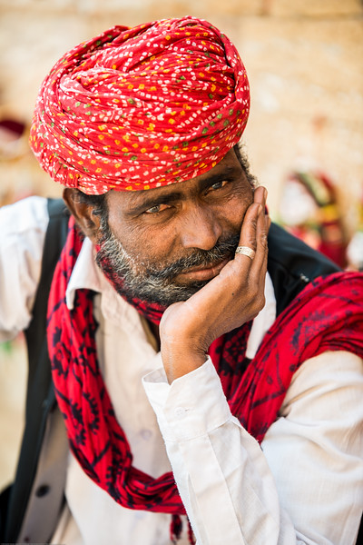 Portrait of a Kathputli (Puppet) maker, Rajasthan. Kathputli means a puppet which is made entirely from wood. However it is made out of wood, cotton cloth and metal wire. Both women and men make the kathputli as well as perform to folk songs. Jaisalmer, Rajasthan, India.