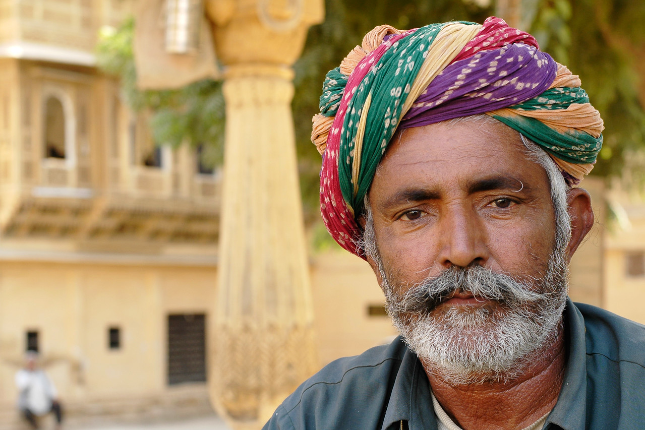 Bright turbaned man sitting outside under the shade. Jaisalmer City, Rajasthan, India.