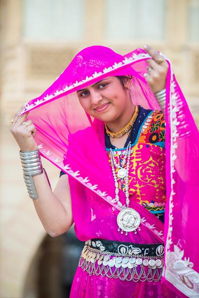 Traditionally dressed Rajasthani lady in Jaisalmer, Rajasthan, India.
