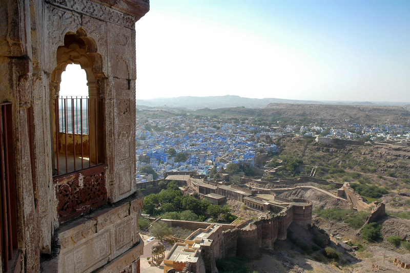 View of the blue city as seen from Mehrangarh Fort, Jodhpur which is situated at an altitude of about 125 metres, the Mehrangarh Fort is spread over an area of 5 sq. km in the heart of the city. The fort has seven gates of which the noted ones are the Jayapol, built by Maharaja Man Singh in 1806; Fatehpol or the Victory Gate built by Maharaja Ajit Singh; and the Lohapol or the Iron Gate.  One can see the strategically located cannons. Jodhpur, Rajasthan, Western India.