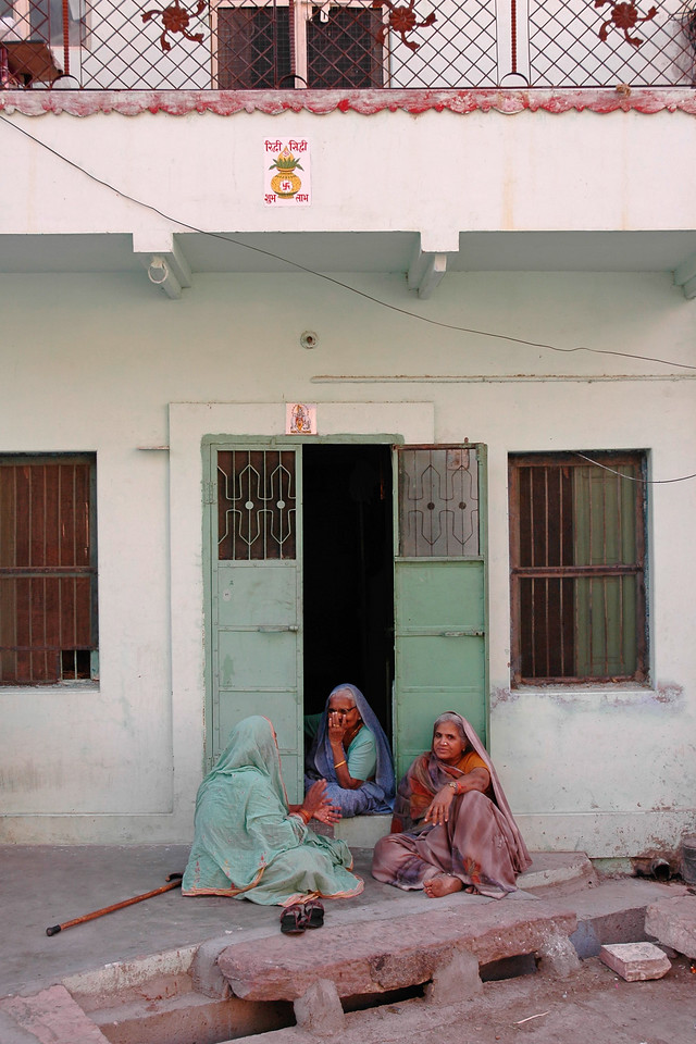 Ladies sitting outside their house and chatting. Daily life in Jodhpur city. Jodhpur is a very popular places for tourists to experience life in Rajasthan, India.