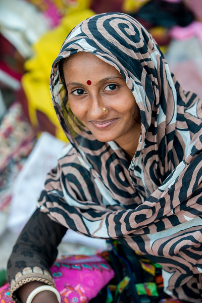 Lady selling clothing material at Ghantaghar market, Jodhpur, Rajasthan, India.