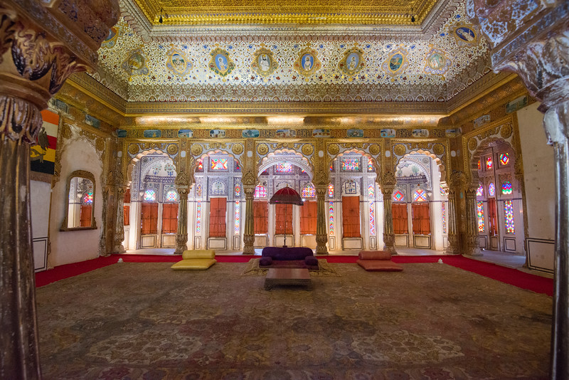 Inside the ornate Phool Mahal: The graceful Sheesh Mahal has symmetrical mirror work. The Moti Mahal served as Diwan-i-Am (Hall of Public Audience). Glass and mirrors used abundantly in what is today Mehrangarh Fort Museum, Jodhpur, Rajasthan, India.