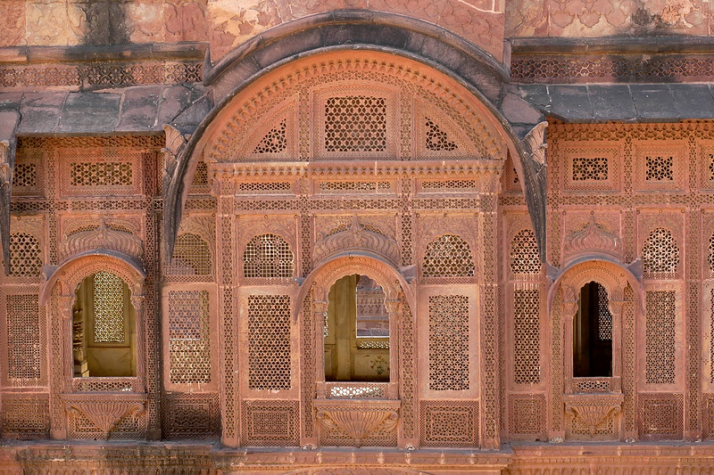 Jharokhas (windows) of the Mehrangarh Fort, Jodhpur. The palace apartments house a splendid collection of the trappings of the Indian royalty. The fort is visited by thousands of tourists every year who come to have a glimpse of the artillery system of the Rajput warriors. One can have a bird's eye view of the city from the fort. Jodhpur, Rajasthan, Western India.
