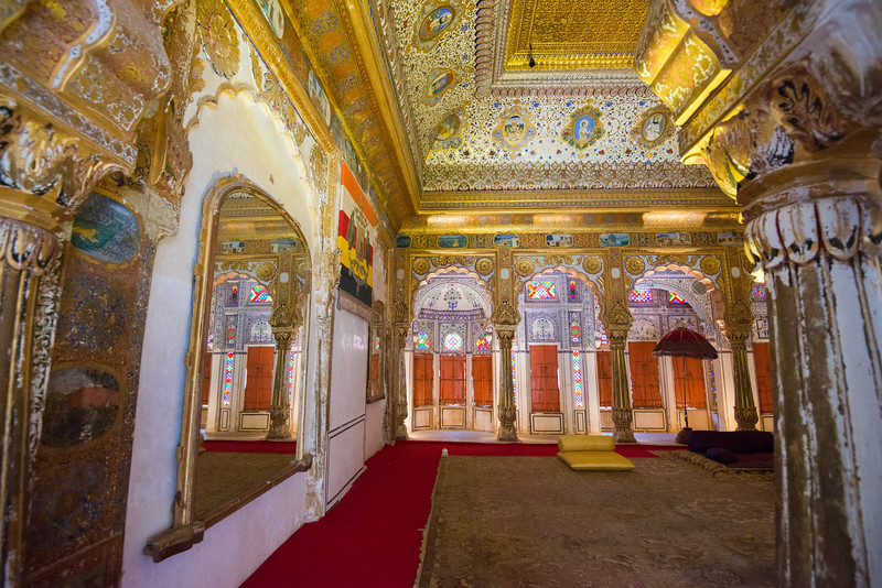 Inside the ornate Phool Mahal: Glass and mirrors used abundantly in what is today Mehrangarh Fort Museum, Jodhpur, Rajasthan, India.
